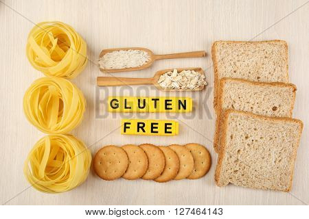 Gluten Free products on wooden background, top view