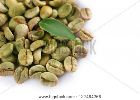 Green coffee beans on white background
