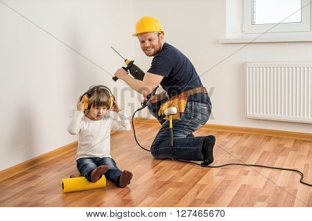poster of construction worker in helmet with a drill and a little child make repairs in the house