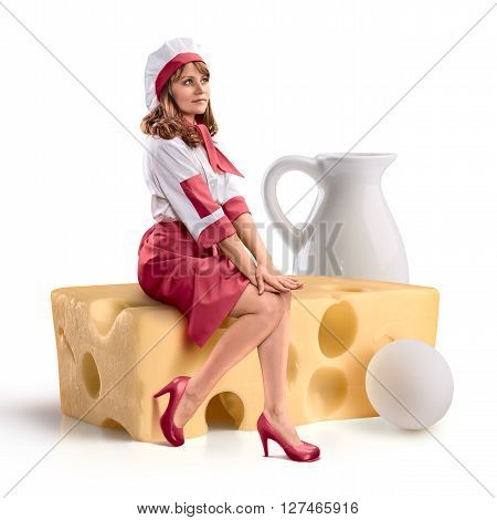 cook girl sitting on a piece of cheese on white isolated background
