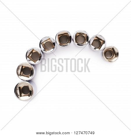 Line of metal hex socket of spanner over isolated white background