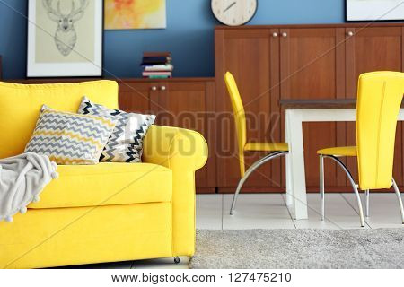 Design interior of living room in yellow colors