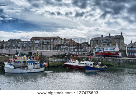 Fishing boats at Seahouses harbour on the Northumberland coast of England