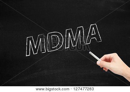 MDMA written on a blackboard