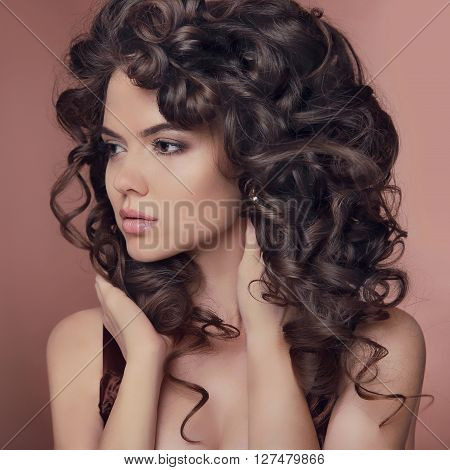 Healthy Hair. Curly Hairstyle. Brunette Girl Model. Beautiful Young Woman With Long Brown Hairs. Pre