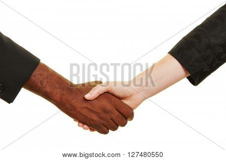Handshake between african and european business people