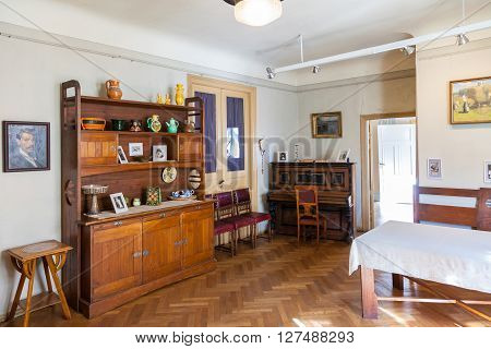 Riga Latvia 26 August 2015: Living room in apartment of latvian artist Janis Rozentals in museum located at Alberta Street 12 in Riga Latvia. poster