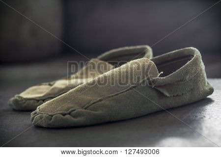 Authentic Native American Indian gathered toe moccasins on rustic wood