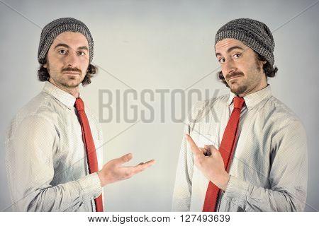 Twin adult men with beards gesturing towards eachother