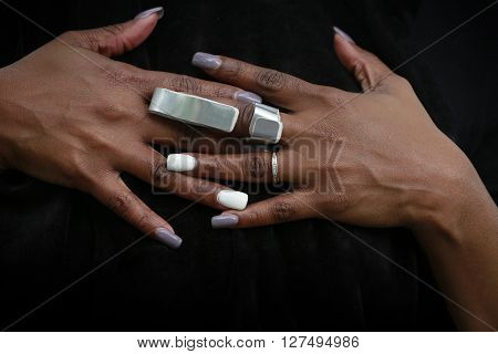 Nicely manicured hand of African-American woman with cast for arthritis or fractured finger poster