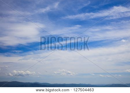 Summer skyscape over endless mountains