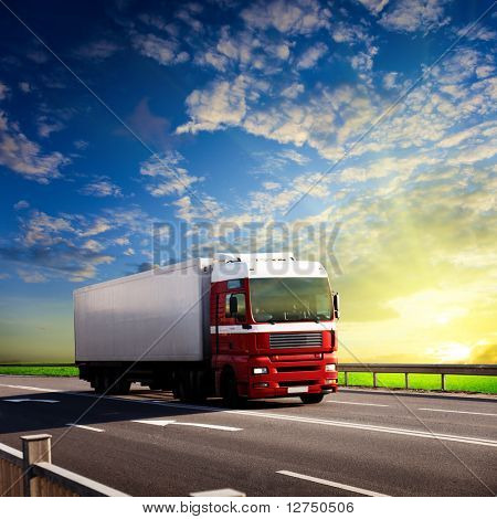 truck on highway and sunset