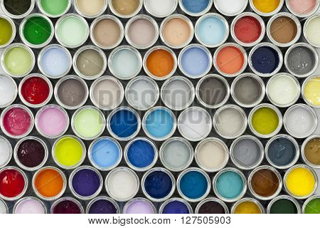 Colourful sample paint pots in various shades.