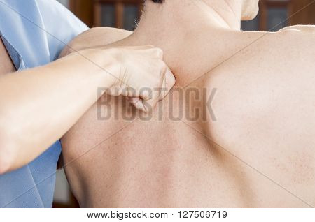 Physiotherapist Is Testing Low Dorsal Over White Background. Quick Scan