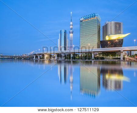 Tokyo Sumida river view with high building and Tokyo Skytree in evening