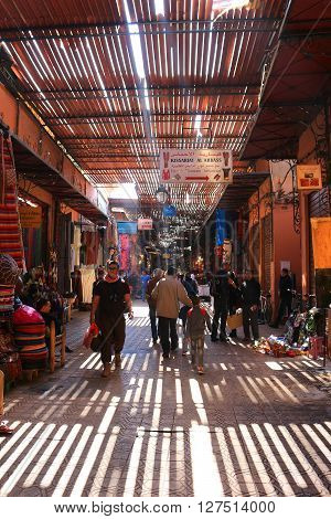 MARRAKECH MOROCCO - MARCH 23 2016: People walking along the pathways of the Souks in Marrakech off of Place Jemaa el-Fna