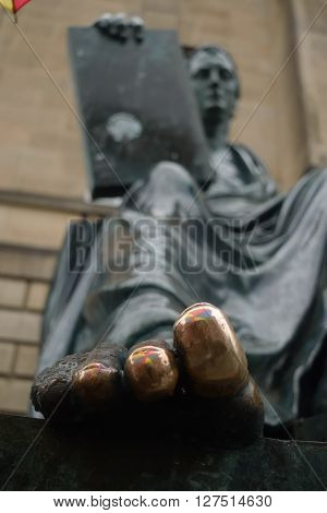 the toe of a statue that has been rubbed to for good luck ** Note: Soft Focus at 100%, best at smaller sizes