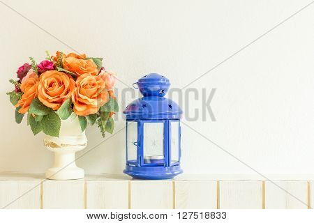 Pastel Artificial Pink Rose Wedding Bridal Bouquet in flower pot and lamp on white background with grunge and vintage tone.