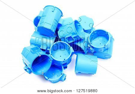 Heap of blue plastic electrical boxes on white background junction boxes accessories for engineering jobs