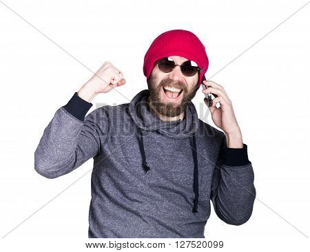 Fashion hipster cool man in sunglasses and colorful clothes, talking on the phone and express different emotions.