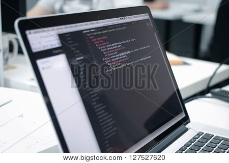 Web Developer's opened laptop with coding script