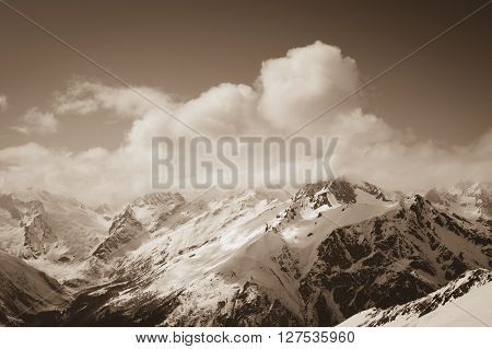 View from ski on snowy mountains. Mountains Caucasus region Dombay. Toned landscape.