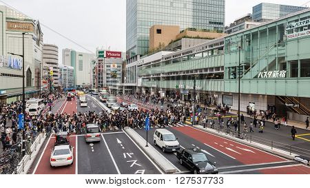 Tokyo Japan - April 9 2016: People for street crossing at Shinjuku Express Bus Terminal. The bus terminal serves mainly Keio Group bus routes is a hab of long distance bus services in Tokyo.
