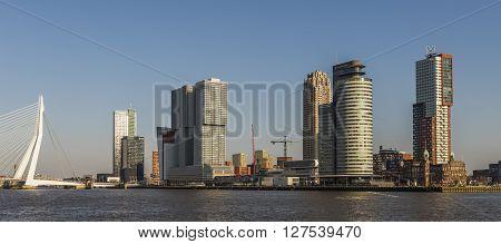 Rotterdam, The Netherlands - February 29, 2016: Wilhelminapier in Rotterdam with skycrapers offices Erasmus Bridge and Hotel New York.