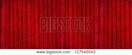 Old red painted wooden wall - texture or background