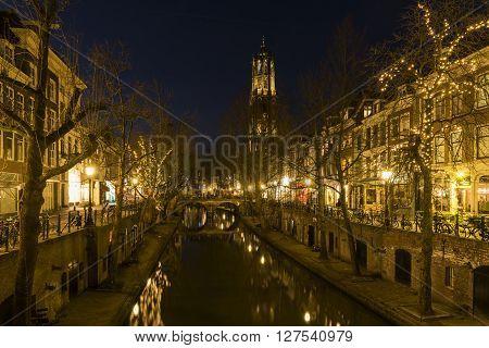 Utrecht, The Netherlands - March 14, 2015: Utrecht at night Oude Gracht bridge houses canal Dom (church).