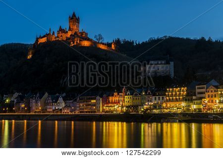 Cochem, Germany - March 28, 2016: Cochem at the Mossele in Germany at night with lights and a great castle Reichsburg.