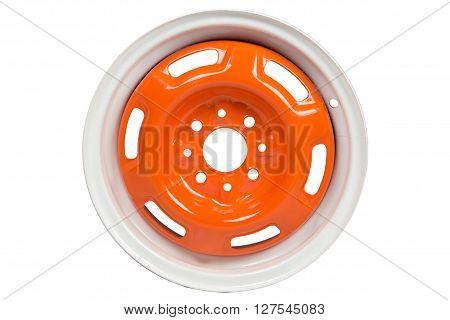 Powder coating of orange wheel disk on white background