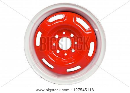 Powder coating of red wheel disk on white background