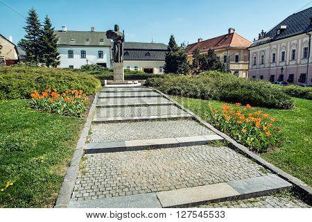 Pribina statue and blooming orange tulips Nitra Slovak republic. Seasonal natural scene. Architecture and gardening. Outdoor scene.