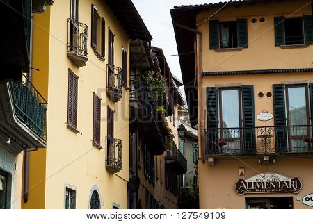 Bellagio, Italy - September 2nd 2015: a quaint street in Bellagio with an Alimentari sign on one of the facades. Bellagio is a popular tourist destination near Lake Como.