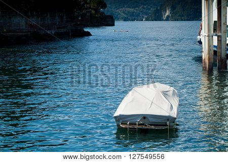 a covered boat photographed near Varenna Lake Como Italy