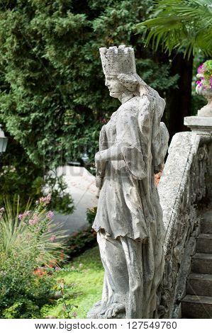 Varenna, Italy - September 4th 2015: white stone statue photographed at Villa Monastero in Varenna Italy.