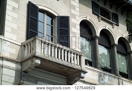 Varenna, Italy - September 4th 2015: closeup photo of a balcony on the facade of Villa Monastero in Varenna Italy.