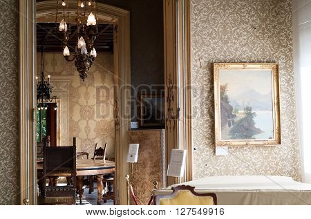 Varenna, Italy - September 4th 2015: entrance to the Green Room (or Conference Room) at Villa Monastero a house museum near Lake Como in Varenna Italy.