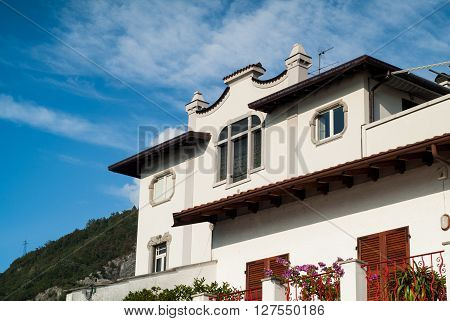 beautiful Italian house against bright blue sky