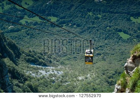 Piani d'Erna Italy - September 7th 2015: a yellow cable car carrying passengers down from Piani d'Erna (part of the Italian Alps)