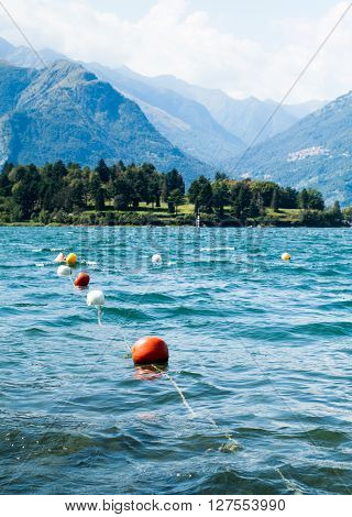 colorful buoys floating on Lake Como photographed from the area near Colico a town in north Italy