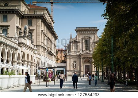Bergamo, Italy - September 9th 2015: people walk outside Santi Bartolomeo e Stefano a 17th century church in Bergamo Italy.