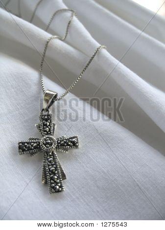 Cross On White Fabric
