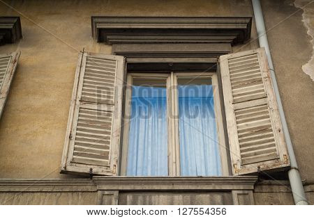 closeup photo of a traditional old window on a house in Italy