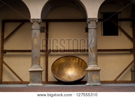Bergamo Italy - September 9th 2015: a big golden bowl photographed at Museo Donizettiano a history museum in the Italian town of Bergamo.