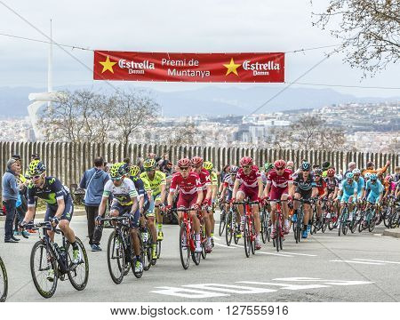 Barcelona Spain - March 27 2016: The peloton riding during Volta Ciclista a Catalunya on the top of Montjuic in Bracelona Spain on March 27 2016.