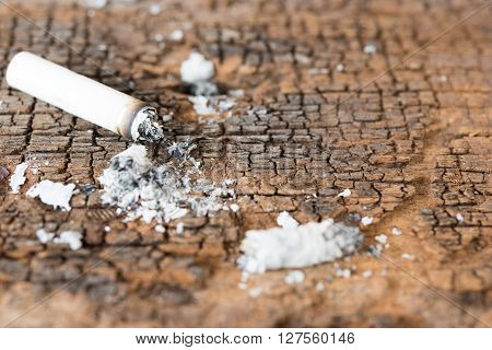 Cigarette on grunge wooden table stop smoking for healthy