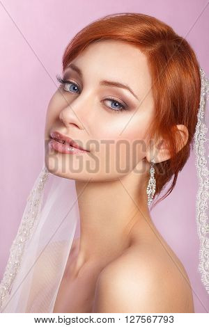 Portrait of a beautiful woman in a wedding dress in the image of the bride. Wedding. Young Gentle Quiet Bride in Classic White Veil. Portrait of beautiful bride. Wedding dress. Wedding decoration poster