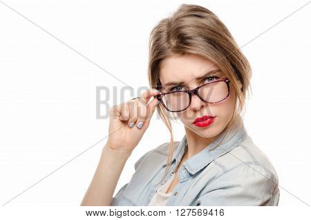 Woman in glasses on white background looking suspiciously